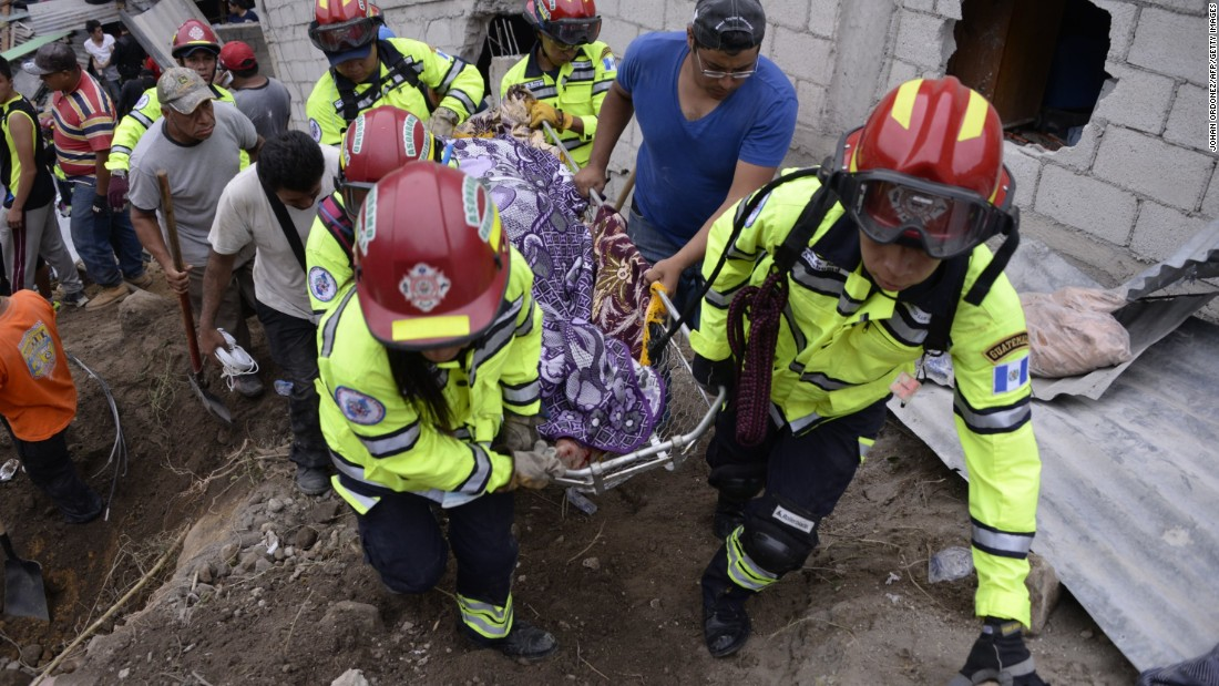 Municipal firefighters recover a body from under the debris on October 2.