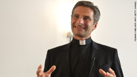 "Father Krysztof Olaf Charamsa, who works for a Vatican office, gives a press conference to reveal his homosexuality, on October 3, 2015 in Rome. The priest said he wanted to challenge what he termed the Church's ""paranoia"" with regard to sexual minorities, claiming the Catholic clergy was largely made up of intensely homophobic homosexuals. The Vatican condemned the coming out of a Polish priest on the eve of a major synod as a ""very serious and irresponsible,"" act which meant he would be stripped of his responsibilities in the Church's hierarchy. In a statement, a spokesman said Krzystof Charamsa would not be able to continue in his senior position in the Vatican and that his future as a priest would be decided by his local bishop.  AFP PHOTO / TIZIANA FABI        (Photo credit should read TIZIANA FABI/AFP/Getty Images)"
