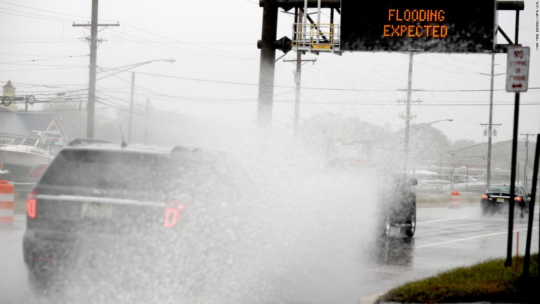 Up to 4 inches of rain could strike the waterfront between Georgia and New Jersey. Motorists deal with the conditions on Friday, October 2, in Seaside Heights, New Jersey.