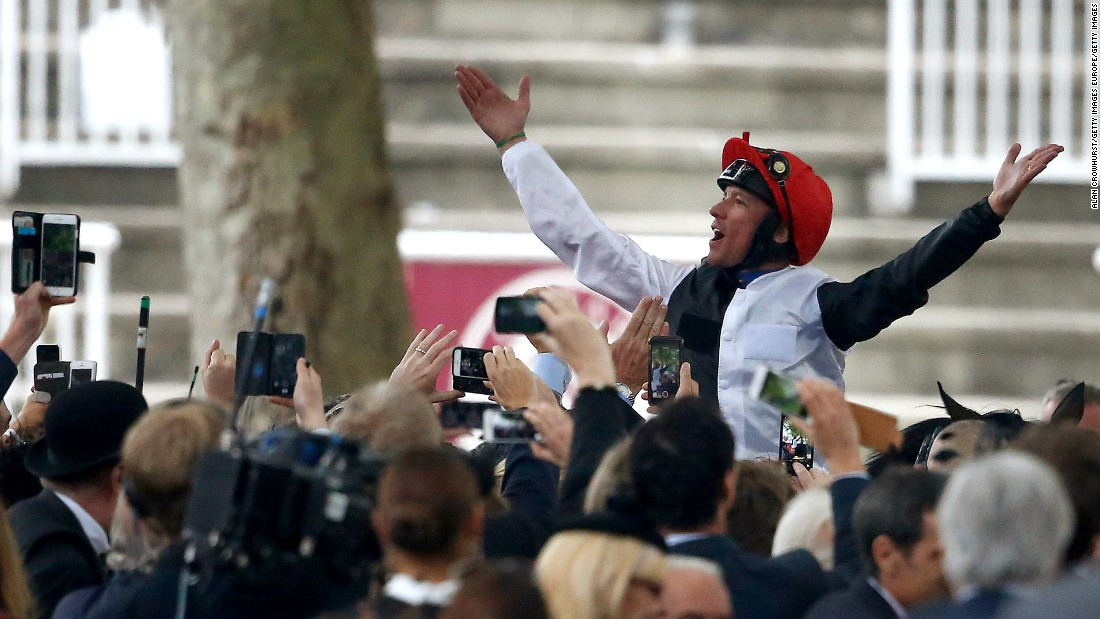 The 44-year-old Dettori savors his fourth victory in the Arc.