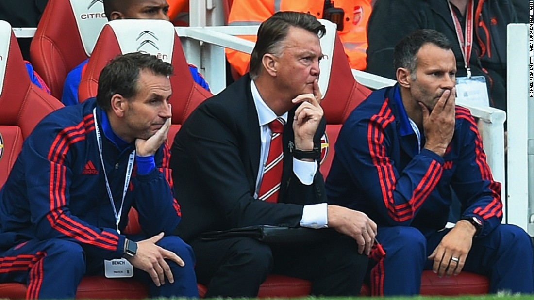 Louis van Gaal and his coaching team looks on in dismay as his team slid to a heavy defeat against Arsenal.