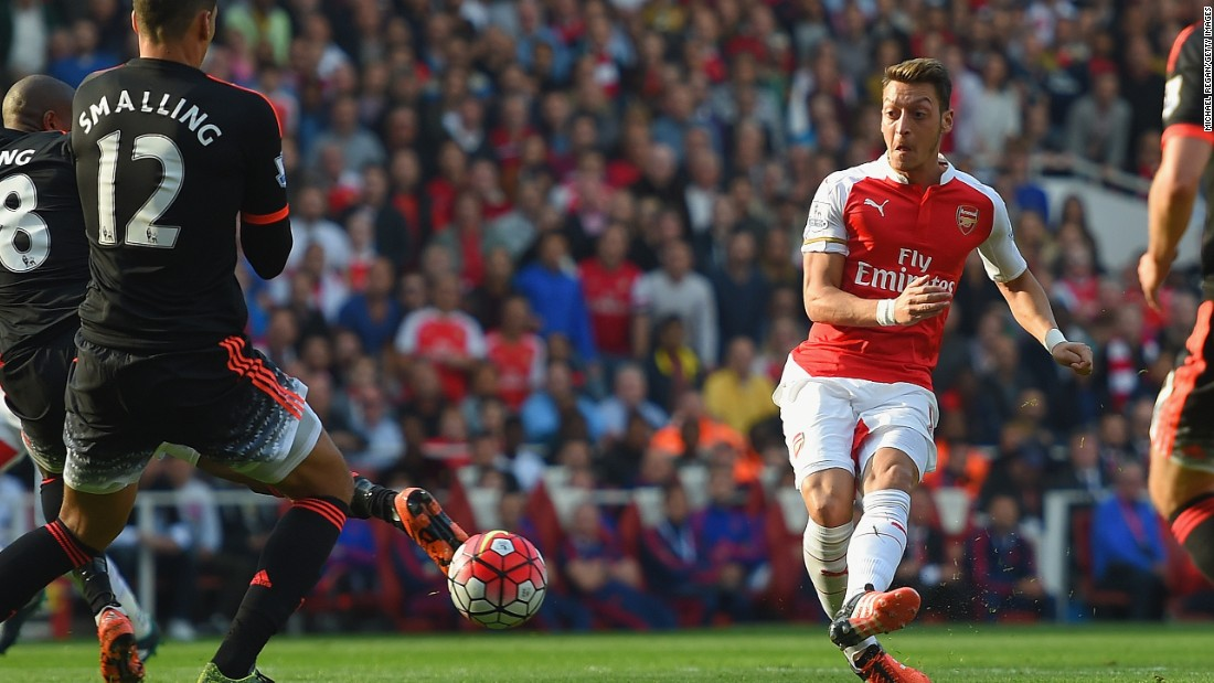 Mesut Ozil sidefoots home Arsenal's second goal as his team took control of the EPL encounter with Manchester United.