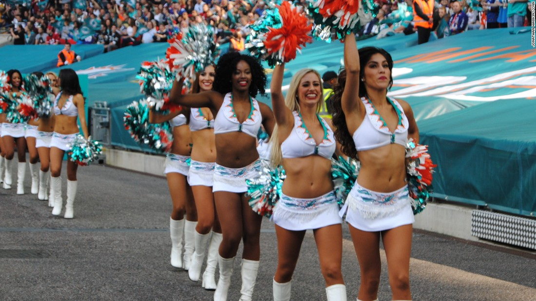 Miami Dolphins cheerleaders strut their stuff at a packed Wembley Stadium.