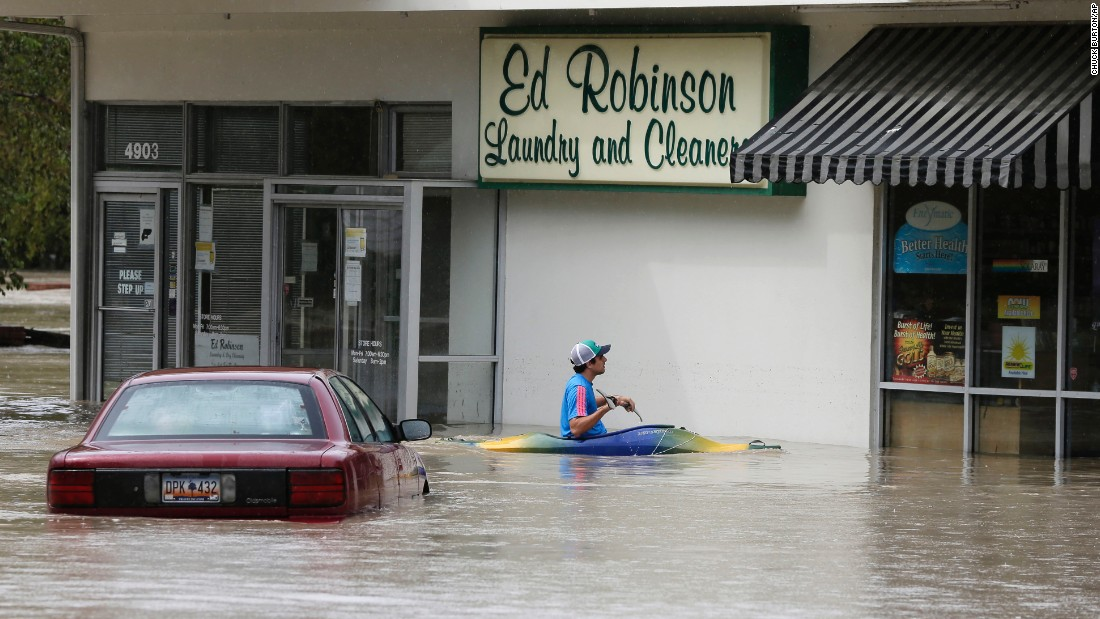 A man paddles up to a flooded store in Columbia, South Carolina, on October 4.
