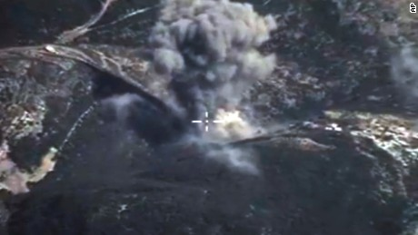 In this photo made from the footage taken from Russian Defense Ministry official web site on Sunday, Oct. 4, 2015, an aerial view of a bomb explosion in Syria. According to information released by the Russian Defense Ministry, Russian aircraft have carried out 20 sorties in Syria in the past 24 hours. (AP Photo/Russian Defense Ministry Press Service)
