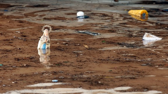 A statue of the Virgin Mary stands in water at the entrance of an underground parking garage in Mandelieu-la-Napoule on October 4.