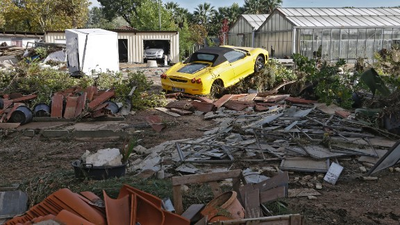 A Ferrari is seen in the middle of debris near Cannes, France, on October 4.