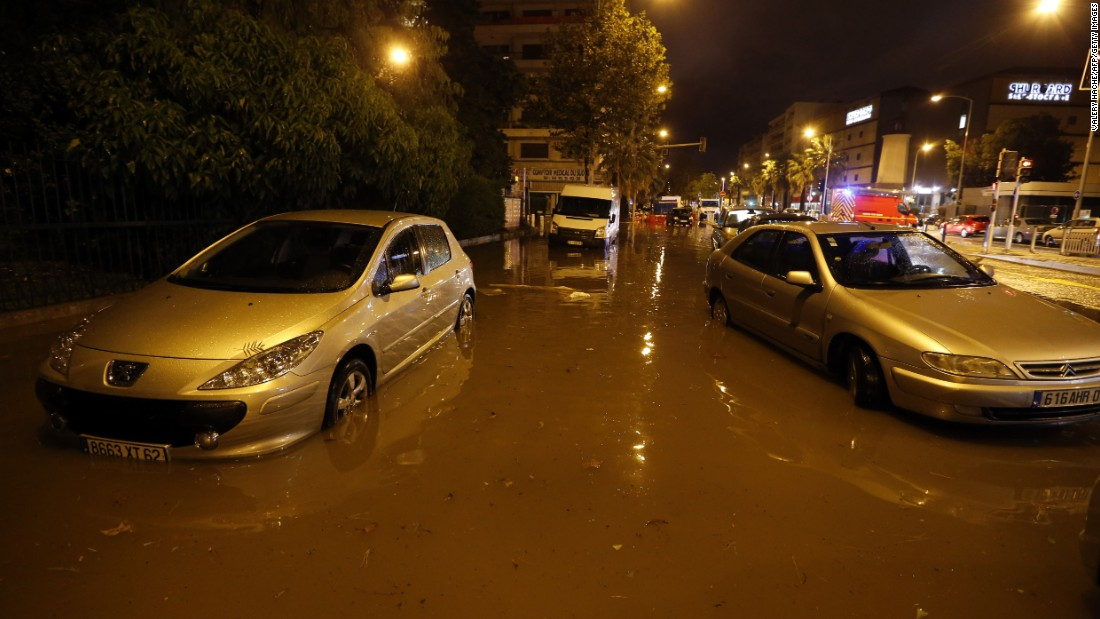 Cars are parked on a flooded street in Nice, France, on Saturday, October 3.