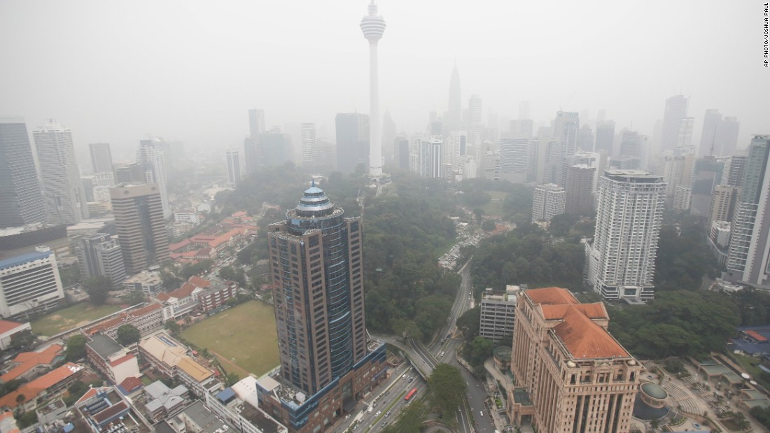 The Kuala Lumpur Tower, center, and other commercial buildings in the downtown area of the Malaysian capital are seen enveloped in haze on September 29, 2015.