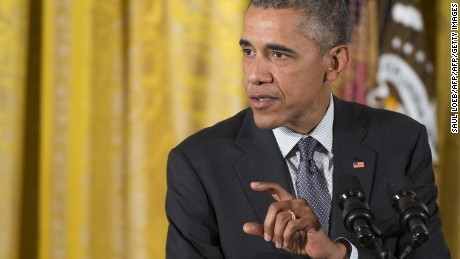 US President Barack Obama speaks before signing H.R. 1295 Trade Preferences Extension Act of 2015, which includes assistance for Americans who lost their jobs to foreign outsourcing, and H.R. 2146 Defending Public Safety Employees' Retirement Act, which includes fast track trade promotion authority (TPA) that allows Obama to negotiate trade treaties, including the Trans Pacific Partnership (TPP), after Obama signed the bills during a bill signing ceremony in the East Room of the White House in Washington, DC, June 29, 2015.