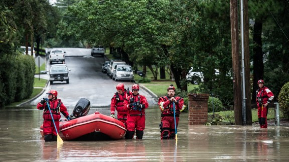 Rescue teams wait for an emergency vehicle in the Forest Acres neighborhood of Columbia on Monday, October 5.