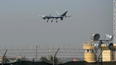 A US drone aircraft lands at Afghanistan's Jalalabad Airport where a US C-130 military transport plane crashed in Jalalabad on October 2, 2015.