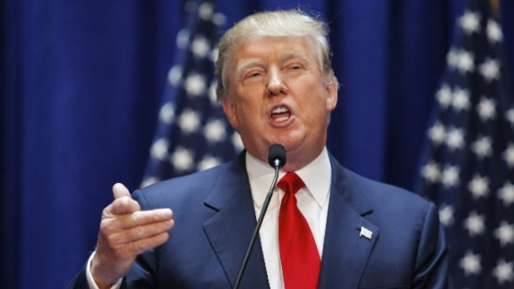 """Real estate mogul Donald Trump announces his bid for the presidency in the 2016 presidential race during an event at the Trump Tower on the Fifth Avenue in New York City on June 16, 2015. Trump, one of America's most flamboyant and outspoken billionaires, threw his hat into the race Tuesday for the White House, promising to make America great again. The 69-year-old long-shot candidate ridiculed the country's current crop of politicians and vowed to take on the growing might of China in a speech launching his run for the presidency in 2016. """"I am officially running for president of the United States and we are going to make our country great again,"""" he said from a podium bedecked in US flags at Trump Tower on New York's Fifth Avenue. The tycoon strode onto the stage after sailing down an escalator to the strains of """"Rockin' In The Free World"""" by Canadian singer Neil Young after being introduced by daughter Ivanka. His announcement follows years of speculation that the man known to millions as the bouffant-haired host of American reality TV game show """"The Apprentice"""" would one day enter politics. Trump identifies himself as a Republican, and has supported Republican candidates in the past. But in his announcement speech he did not explicitly say if he was running for the party's nomination or as an independent.AFP PHOTO/ KENA BETANCUR        (Photo credit should read KENA BETANCUR/AFP/Getty Images)"""