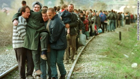 Ethnic Albanian refugees arrive by foot in Macedonia in April 1999 after being forced to leave a train coming from Pristina in Kosovo.