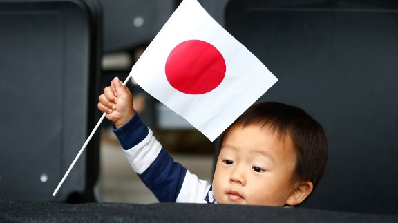MILTON KEYNES, ENGLAND - OCTOBER 03:  A young Japan fan flies the flag during the 2015 Rugby World Cup Pool B match between Samoa and Japan at Stadium mk on October 3, 2015 in Milton Keynes, United Kingdom.  (Photo by Laurence Griffiths/Getty Images)