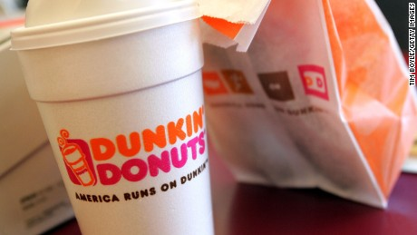 Dunkin' Donuts says it will work with store owners and employees after complaints from police officers.