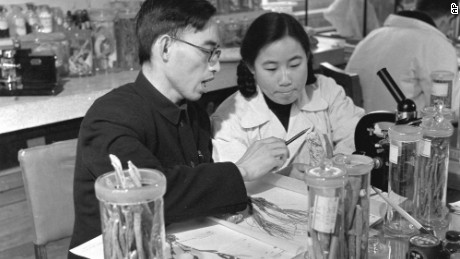 This photo taken in the 1950s shows Tu Youyou, right, a young pharmacologist with the China Academy of Chinese Medical Sciences in Beijing.