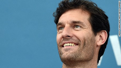 Australia's former Formula One driver Mark Webber watches the women's singles quarter-final match between Carla Suarez Navarro of Spain and Maria Sharapova of Russia at the Brisbane International tennis tournament in Brisbane on January 8, 2015.      AFP PHOTO / Saeed KHAN IMAGE RESTRICTED TO EDITORIAL USE - STRICTLY NO COMMERCIAL USE        (Photo credit should read SAEED KHAN/AFP/Getty Images)
