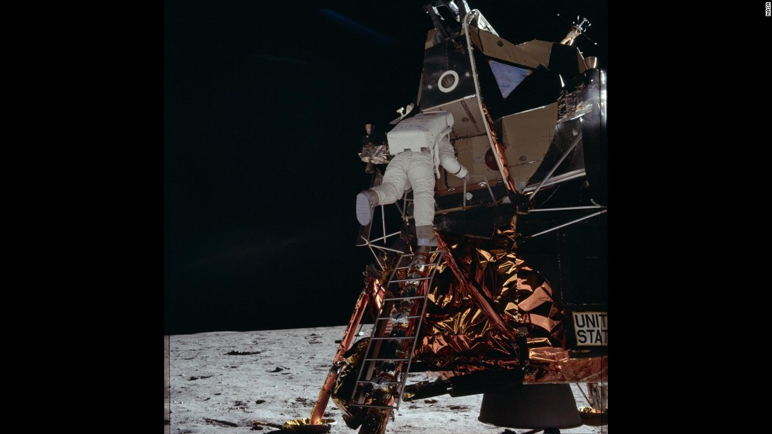 "Aldrin walks down the steps of the lunar module, codenamed ""Eagle,"" as he prepares to walk on the moon."