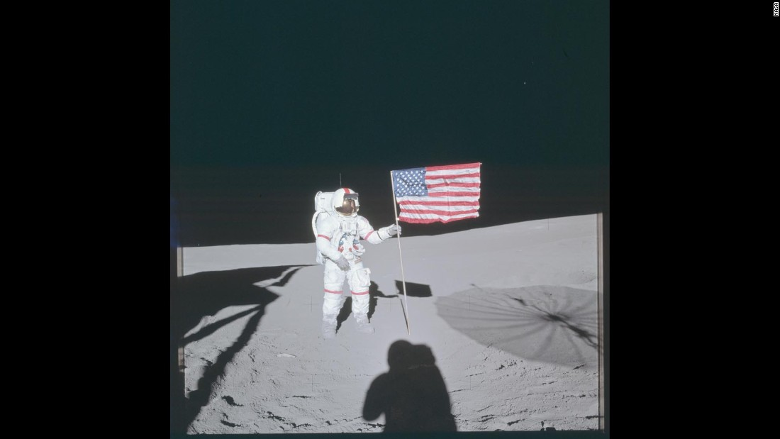 Apollo 14 commander Alan Shepard poses next to the American flag while walking on the moon's surface in February 1971.