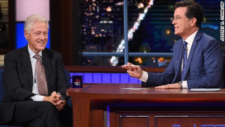"In this image released by CBS, President Bill Clinton, left, appears with host Stephen Colbert during a taping of ""The Late Show with Stephen Colbert."""