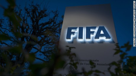 This photo taken on September 25, 2015 shows an entrance sign to the FIFA world football governing body's headquarters in Zurich. The FIFA scandal on Friday engulfed Sepp Blatter and Michel Platini, the two most powerful figures in world football, with Swiss prosecutors investigating whether a two million dollar payment from Blatter to the French legend was illegal. Swiss investigators opened criminal proceedings against FIFA president Blatter and searched his office as they also quizzed UEFA counterpart Platini. AFP PHOTO / FABRICE COFFRINI        (Photo credit should read FABRICE COFFRINI/AFP/Getty Images)