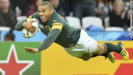 South Africa's wing Bryan Habana scores his team's third try during a Pool B match of the 2015 Rugby World Cup between South Africa and USA at the Olympic Stadium, east London, on October 7, 2015.  AFP PHOTO / GLYN KIRK  RESTRICTED TO EDITORIAL USE, NO USE IN LIVE MATCH TRACKING SERVICES, TO BE USED AS NON-SEQUENTIAL STILLS        (Photo credit should read GLYN KIRK/AFP/Getty Images)