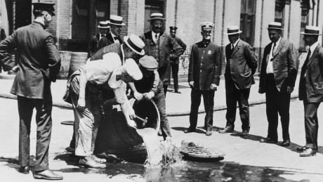 Alcohol is poured away into a New York sewer during the prohibition era, circa 1920. (Photo by FPG/Hulton Archive/Getty Images)