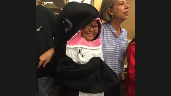 Zoey Lambe-Hommel, 7,  protested in an orca costume.