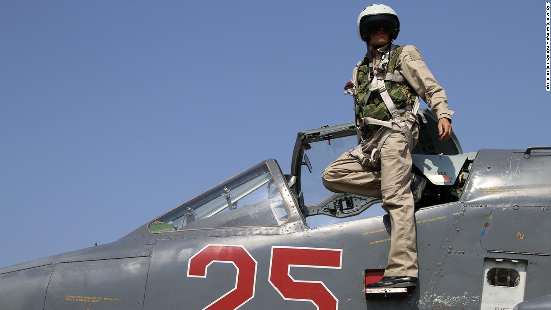 "A Russian army pilot poses in the cockpit of a jet fighter at Hmeimim air base in Syria on Saturday, October 3. Since the Russians began operating in Syrian airspace, <a href=""http://www.cnn.com/2015/10/07/politics/u-s-diverts-aircraft-to-avoid-russian-fighter/"" target=""_blank"">U.S. pilots have been under orders</a> to change their flight path if there is a Russian plane within 20 nautical miles, according to a senior defense official."