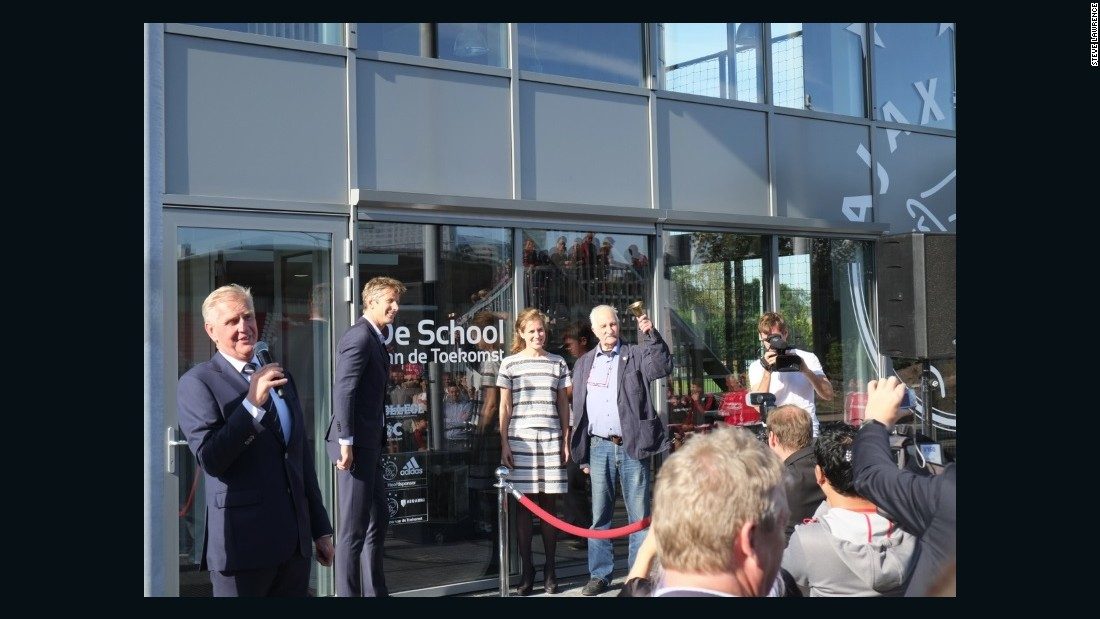 Now as well as developing players' skills on the pitch, the club's aspiring pros can now receive education at a dedicated school. Here the new building school building is officially opened by Ajax marketing director Edwin Van der Sar (second left), who was a former goalkeeper of the Dutch club, as well as Juventus and Manchester United.