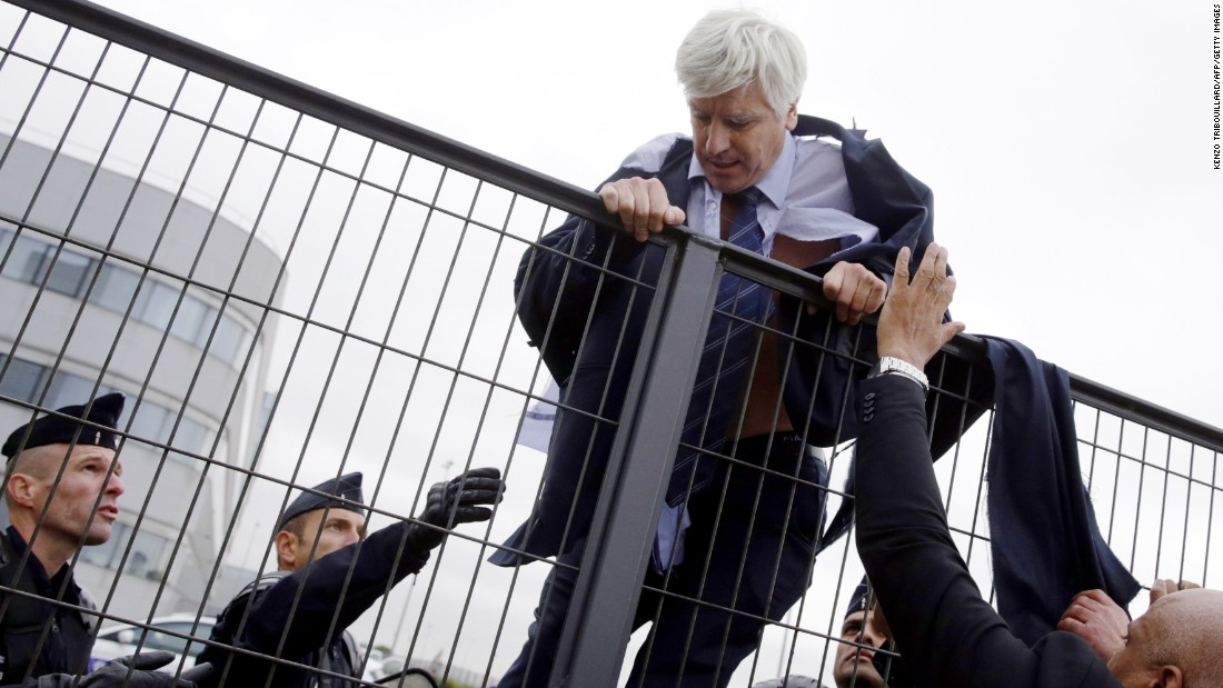 "Director in charge of human resources of Air France, Pierre Plissonnier, is helped by security and police officers to climb a fence after several hundred protesters stormed into the offices of Air France, interrupting the meeting of the Central Committee, on Monday, October 5. <a href=""http://money.cnn.com/2015/10/05/news/companies/air-france-jobs-protest-shirts/"" target=""_blank"">Angry protesters</a> ripped the shirts off Air France executives during a meeting near Paris after the company revealed plans to cut thousands of jobs."