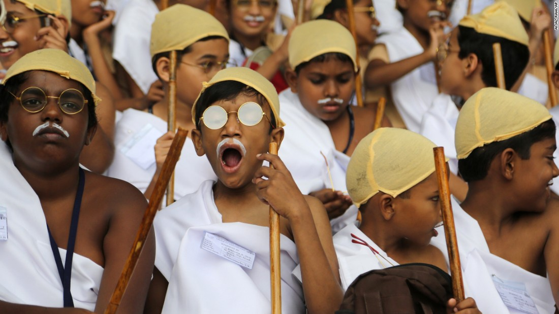 A boy dressed as India's independence leader Mahatma Gandhi yawns as he participates with others in an attempt to create a Guinness record during celebrations to mark Gandhi's birth anniversary in Bangalore, India, on Friday, October 2. Organizers said 4,605 children participated in the event to break the record of largest gathering of people dressed as Gandhi.