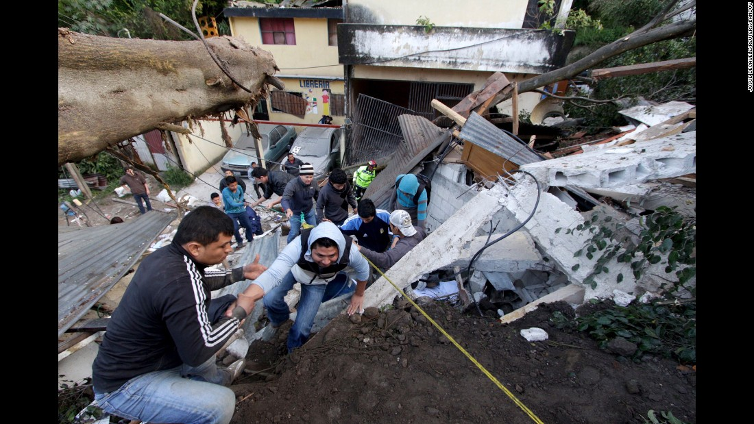 "Residents make their way out of an area affected by <a href=""http://www.cnn.com/2015/10/04/americas/guatemala-landslide-dead-missing/"" target=""_blank"">a landslide</a> on the outskirts of Guatemala City on Friday, October 2. By Sunday evening, the ministry was reporting 131 people were dead and more than 300 still missing."