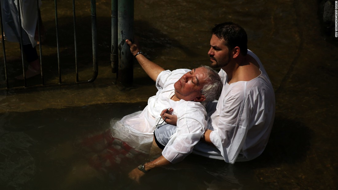 Evangelical Christian pilgrims from Brazil attend a mass baptism in the waters of the Jordan River in northern Israel on Friday, October 2.