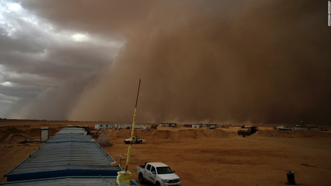 A sandstorm sweeps by a highway construction site in the desert north of Cairo on Tuesday, October 6.