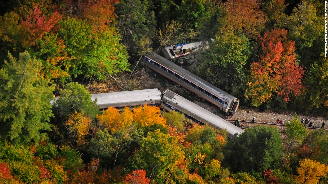 "Railroad cars from <a href=""http://www.cnn.com/2015/10/05/us/gallery/vermont-train-derailment/index.html"" target=""_blank"">a derailed Amtrak passenger train</a> are scattered on Monday, October 5, in Northfield, Vermont. The train was headed from Vermont to Washington when it apparently struck rocks that were on the tracks. No life-threatening injuries were reported."