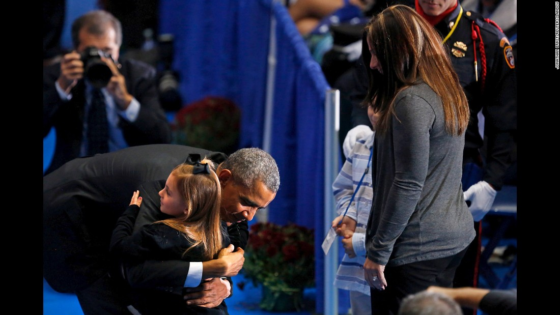 President Barack Obama greets family members of fallen firefighters after delivering remarks at the annual National Fallen Firefighters Memorial Service in Emmitsburg, Maryland, on Sunday, October 4.