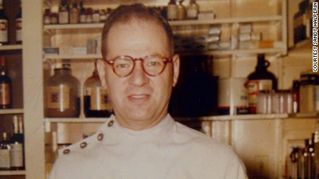 Sandy Halperin's father, Leon, standing in his pharmacy. Leon died of Alzheimer's in 1998.