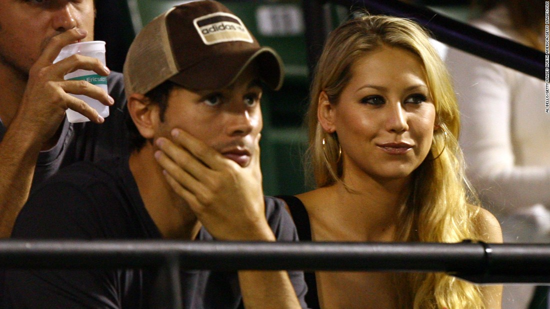 "The beautiful tennis player started dating pop singer Enrique Iglesias after appearing in the video for his 2001 single ""Escape."""