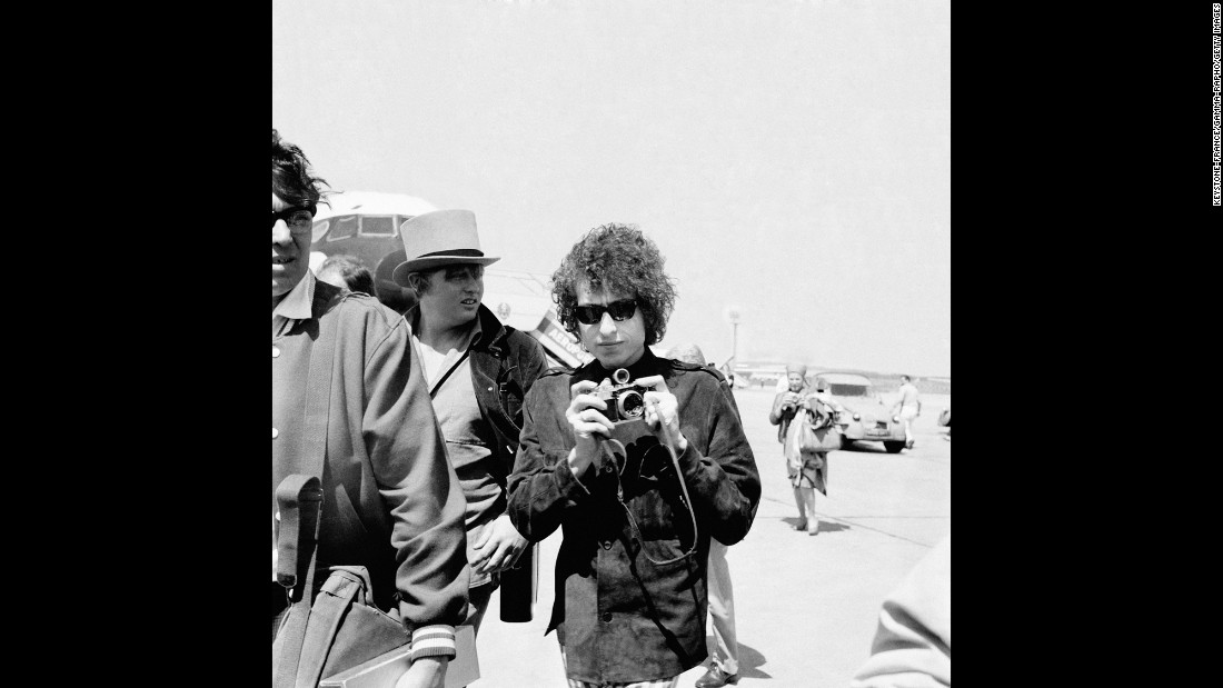 "Many of the concerts were raucous affairs, with audience members yelling at Dylan and Dylan yelling back. (The Manchester, England, show was captured on ""Live 1966: The 'Royal Albert Hall' Concert."") Dylan left for France on May 22; this photo shows him arriving at Le Bourget Airport in Paris."