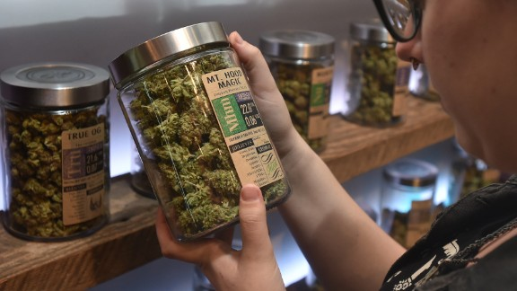 A woman shops at Oregon's Finest, a marijuana dispensary in Portland, Oregon, on October 4, 2015. As of October 1,2015 limited amounts of recreational marijuana became legal for all adults over the age of 21 to purchase in the state of Oregon.
