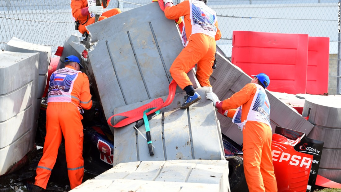 Marshalls remove barriers from the top of the Toro Rosso of Carlos Sainz Jr. after the Spaniard's high speed crash at the Russian Grand Prix.