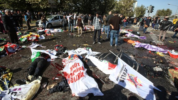 Bodies lay covered with flags and banners at the blast site.