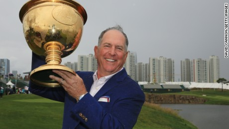 United States captain Jay Haas lifts the Presidents Cup after his team's narrow victory over the Internationals in South Korea.