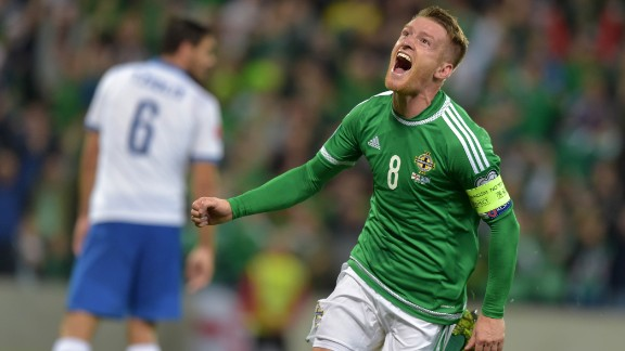 Northern Ireland reached its first major tournament in 30 years, topping Group F by one point from Romania.