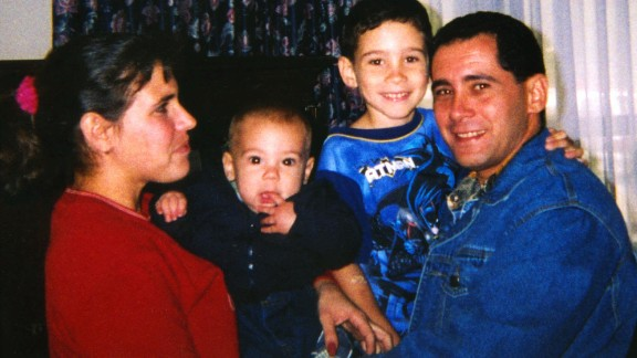 Elian was reunited with his father in April 2000, after the raid. Here, he poses with his father, half-brother and stepmother at Andrews Air Force Base in Maryland.
