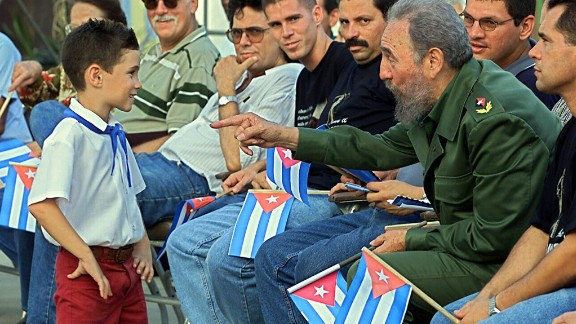 Castro, second from right, talks with Elian in July 2001 in Cardenas, during a political gathering to inaugurate the Museo a la Batalla de Ideas, the Museum of the Battle of Ideas, which highlights Castro