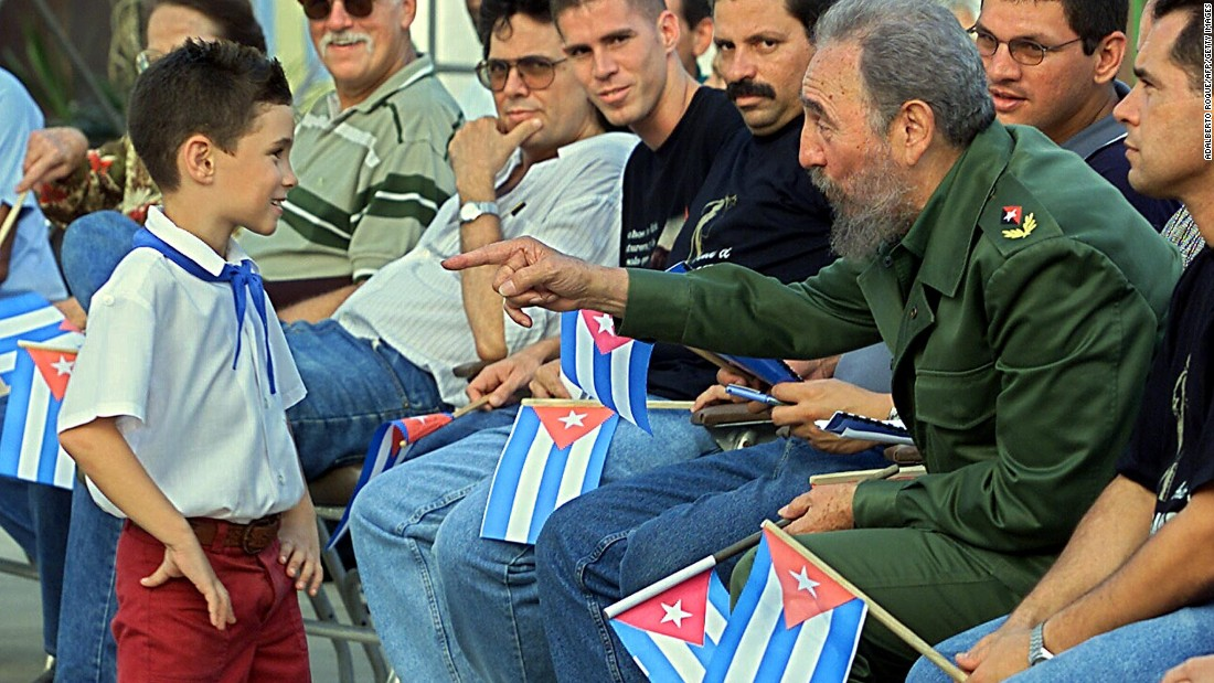 "Castro, second from right, talks with Elian in July 2001 in Cardenas, during a political gathering to inaugurate the <a href=""http://www.museobatalladeideas.cult.cu/"" target=""_blank"">Museo a la Batalla de Ideas</a>, the Museum of the Battle of Ideas, which highlights Castro's clashes with the U.S. over the years and the propaganda victory that the Elian affair provided Castro's revolution. A diverse range of objects relating to Elian's custody battle in the U.S. was exhibited. To the right is Elian's father, who went from being a waiter to being a member of the country's National Assembly."