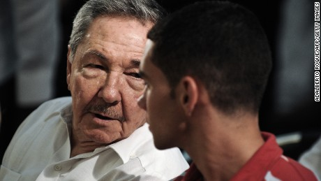 Cuban President Raul Castro (L) is seen with Cuban rafter-boy Elian Gonzalez (R), on June 30, 2010 in a church of Havana, during the celebration of 10th Anniversary of Elian's return from Miami.   AFP PHOTO/ADALBERTO ROQUE (Photo credit should read ADALBERTO ROQUE/AFP/Getty Images)